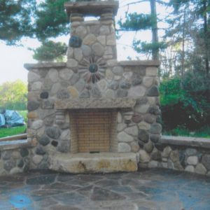 Fieldstone Fireplace on Southern Sandstone flagstone patio installed by Stum Masonry